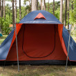 Blue tent with red entrance — Stock Photo