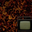 Old tv with grunge background — Stock Photo