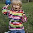Stock Photo: Little girl playing with ball