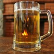 A mug of beer on a wooden table — Stock Photo