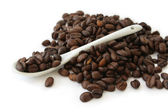 Coffee beans and spoon — Stock Photo