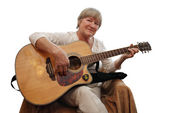 Mature woman playing acoustic guitar — Stock Photo