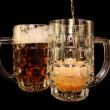 Beer is poured into a mug — Stock Photo
