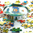Stock Photo: Magnifying glass and puzzle