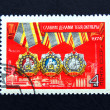 Old Russian postage stamp with Soviet award — Stock Photo