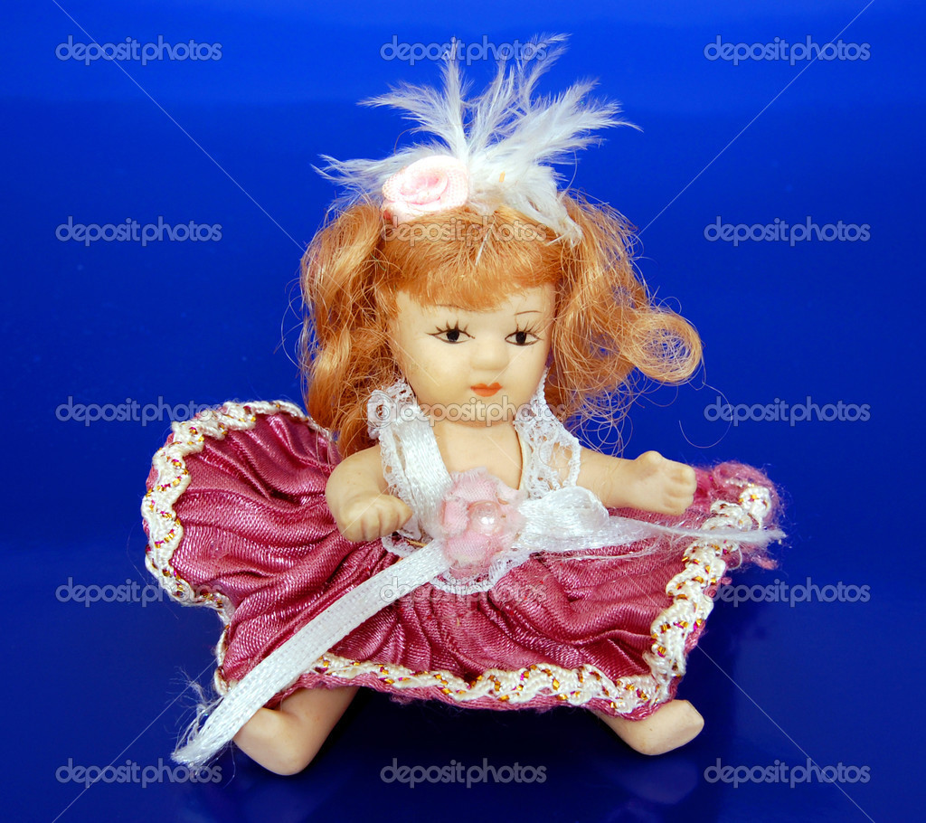 Old Porcelain Doll on blue background — Stock Photo #2904822
