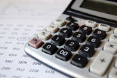 Calculator and financial information — Stock Photo