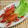 Boiled crayfishs and lettuce on plate — Stock Photo