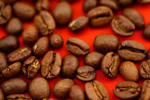 Coffee beans on red background — Stock Photo