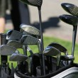 Golf clubs and umbrella in the bag - Stock Photo
