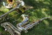 Saxophones and trombones — Stock Photo