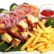 Chiken shish kebab with fried potatoes - Stock Photo