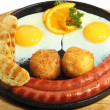 Smiling fried eggs with sausages - Stock Photo