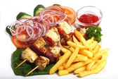Chiken shish kebab with fried potatoes — Stock Photo