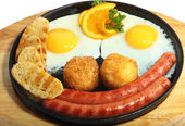 Smiling fried eggs with sausages — Stock Photo