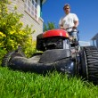 Stock Photo: Mow the lawn