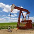 Stock Photo: Red pump jack