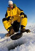 Winter fisherman — Stock Photo