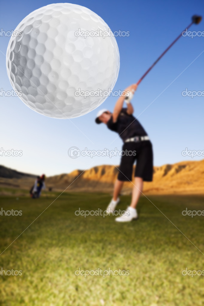 A golfer driving the ball down the fairway focus on the ball — Stock Photo #2965501