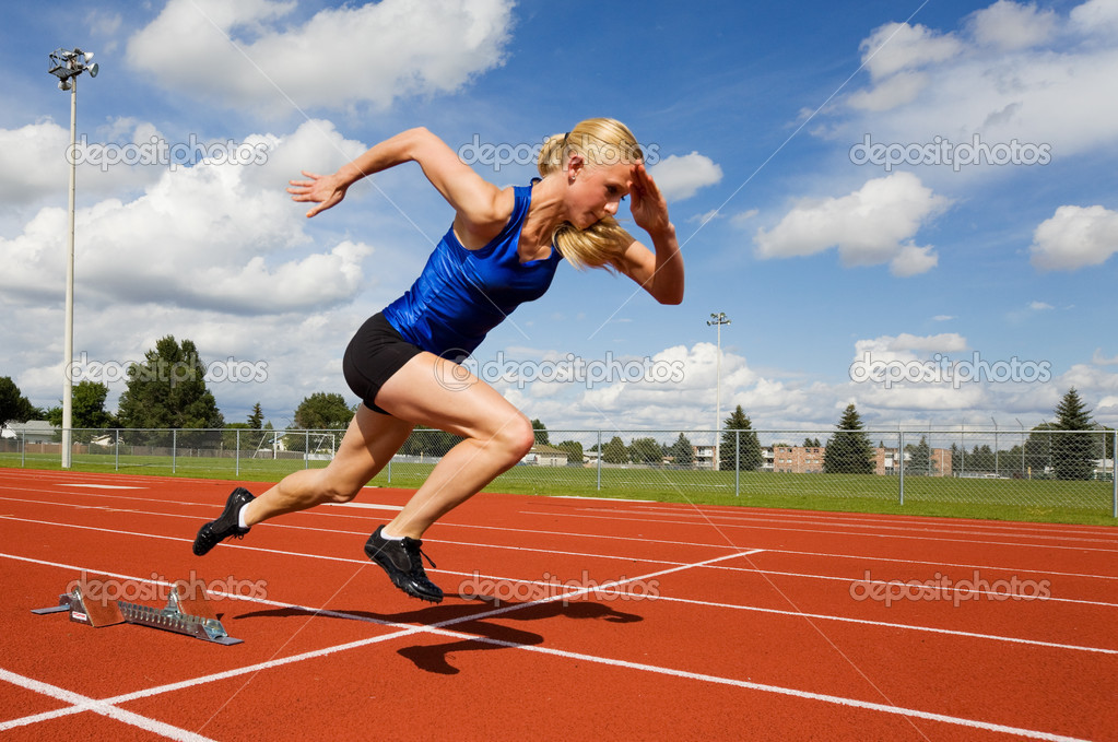 Track athlete exploding out of the starting blocks — Stock Photo #2965795