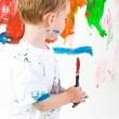 图库照片: Child painting wall