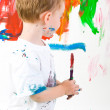 Foto de Stock  : Child painting wall