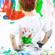 图库照片: Child painting on wall
