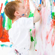 Child painting on wall — Stock Photo #2968492