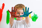 Child with painted hands — Stok fotoğraf