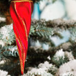 Red twisty Christmas icicle — Stock Photo