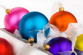 Christmas baubles boxed and unboxed — Stock Photo