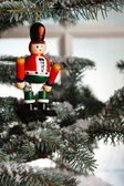 Christmas toy solider on tree — Stock Photo