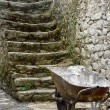 Old stairs with wheelbarrow — Stock Photo