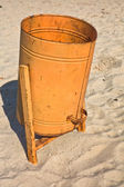 Orange garbage can on the beach — Stock Photo