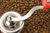 Coffemill with coffeebeans — Stock Photo