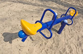An empty seesaw in a playground — Stock Photo