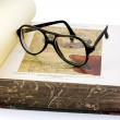 An open old book and spectacles — Stock Photo