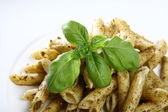 Penne with pesto — Stock Photo