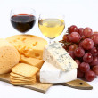 Various types of cheese, wine and grapes — Stock Photo #2995680