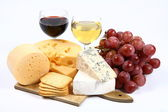 Various types of cheese, wine and grapes — Stock Photo