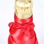 Champagne bottleneck in satin — Stock Photo