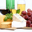 Various types of cheese and wine - Stock Photo