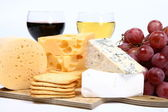 Types of cheese, wine, grapes, crackers — Stock Photo