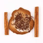 Christmas cookie and cinnamon sticks — Stock Photo