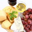 Stock Photo: Various types of cheese, grapes, wine