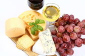 Various types of cheese, grapes, wine — Stock Photo
