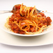 Spaghetti bolognese on a plate being eaten — Foto Stock