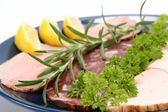 Plate of assorted cold cuts — Stock Photo