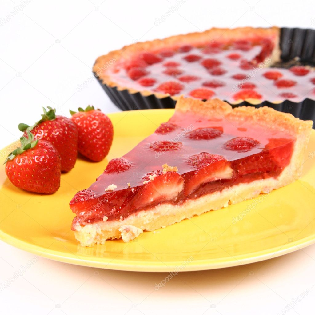 Piece of Strawberry Tart with a tart in a tart pan  Stock Photo #3706585