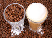 Caffe latte and coffee beans — Stock Photo
